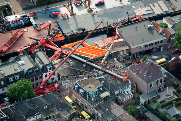 An aerial picture taken on August 3, 2015 shows the two cranes that have fallen onto houses in Alphen aan den Rijn. AFP/Getty Images