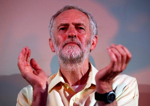 Jeremy Corbyn claps as he is applauded following a speech at a Labour party leadership rally on August 3, 2015 in London, England (Photo by Carl Court/Getty Images)