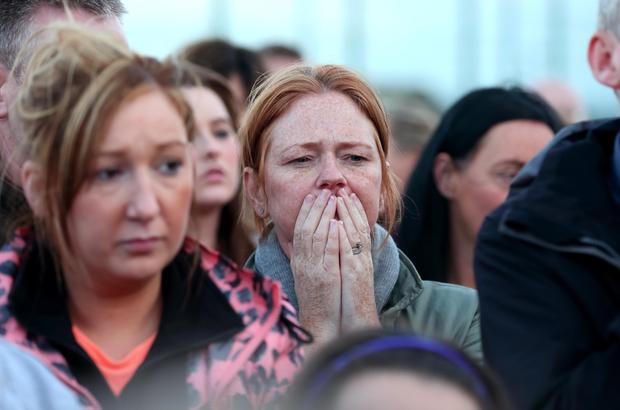 Members of the public in the Lagmore area holding a vigil for murder victim Jennifer Dornan. Photo: Kevin Scott / Presseye