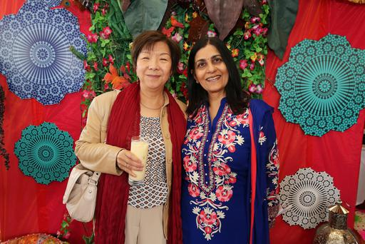 Celebrating the cultural wealth of nations at the programme launch today in the Indian Roof Garden of The Merchant Hotel are Anna Lo and Nisha Tandon.