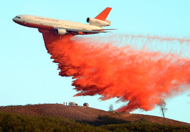 An air tanker drops fire retardant along a ridge to help contain the Rocky fire near Clearlake. AFP/Getty Images