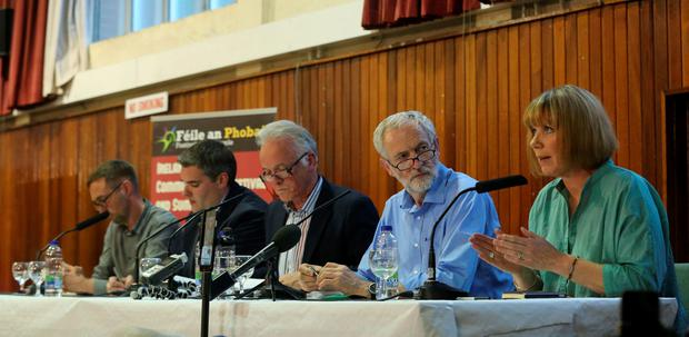 (Left - right) Sinn Fein councillor Eoin O Broin, DUP's Gavin Robinson MP, Chair Noel Thompson, Jeremy Corbyn and comedian Nuala Mckeever during the West Belfast Talks Back panel at St Louise's College. Photo: Niall Carson/PA