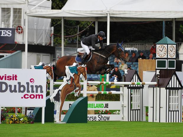 Victory parade: Ulsterman Dermott Lennon and Loughview Lou Lou on way to victory in the Irish Sports Council Classic at the Discover Ireland Dublin Horse Show at the RDS