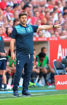 Tottenham's head coach Mauricio Pochettino gestures during the friendly soccer match between AC Milan and Tottenham Hotspur, in the Allianz Arena stadium in Munich