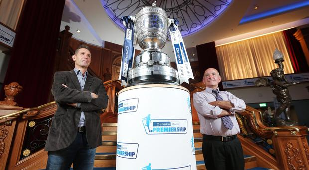 Eyes on the prize: Crusaders manager Stephen Baxter and Cliftonville boss Tommy Breslin admire the Gibson Cup during last night's Danske Bank Premiership launch at Titanic Belfast