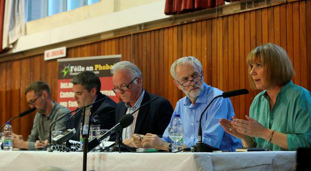 (Left - right) Sinn Fein councillor Eoin O Broin, DUP's Gavin Robinson MP, Chair Noel Thompson, Jeremy Corbyn and comedian Nuala Mckeever during the West Belfast Talks Back panel at St Louise's College, as the Labour leadership contender has said the British Government needs to fund Northern Ireland's welfare system properly and warned of increased poverty because of Tory plans. PRESS ASSOCIATION Photo. Picture date: Wednesday August 5, 2015. See PA story POLITICS Labour Corbyn. Photo credit should read: Niall Carson/PA Wire