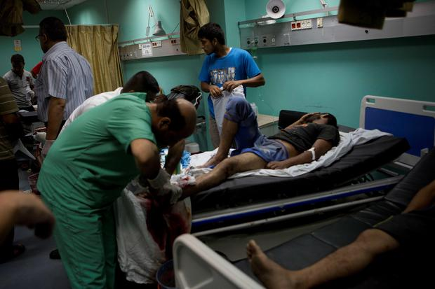 Palestinian men are treated at a hospital in the southern Gaza Strip town of Rafah following an explosion that ripped through a house in the nearby Al-Shabura refugee camp on August 6, 2015. AFP/Getty Images
