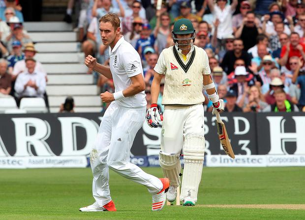England's Stuart Broad (L) celebrates taking the wicket of Australian batsman Mitchell Starc (R) on the first day of the fourth Ashes cricket Test match between England and Australia at Trent Bridge in Nottingham. AFP/Getty Images