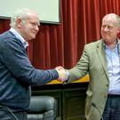 Chief Constable George Hamilton shakes hands with Deputy First Minister Martin McGuinness during the Feile 2015 event. Photo: Kevin Scott / Presseye