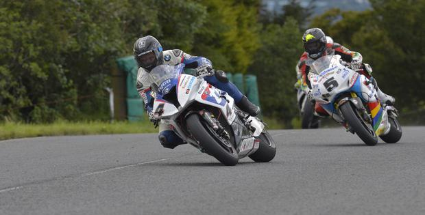 Guy Martin leads Bruce Anstey just before his crash at the Ulster Grand Prix Dundrod 150 Superbike. Pic Rowland White/PressEye