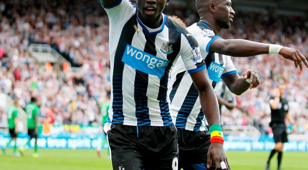 Newcastle United's Papiss Demba Cisse celebrates his equaliser during the Barclays Premier League match at St James' Park, Newcastle. Richard Sellers/PA Wire.