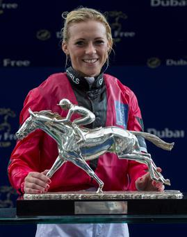 Jockey Sammy Jo Bell of the Girls Team poses with the trophy after the Dubai Duty Free Shergar Cup at Ascot Racecourse, Ascot. Julian Herbert/PA Wire.