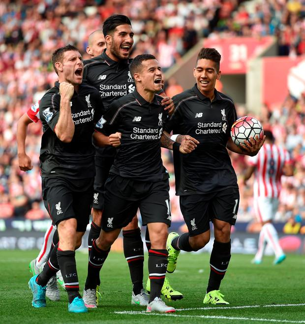 Liverpool's Philippe Coutinho (front, centre) celebrates scoring his side's first goal of the game during the Barclays Premier League match at the Britannia Stadium, Stoke-on-Trent. Martin Rickett/PA Wire.