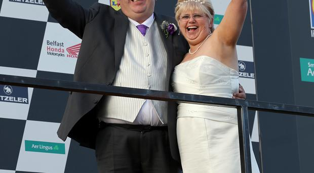 Billy Oliver and his wife Babs celebrate their wedding day at the Ulster Grand Prix