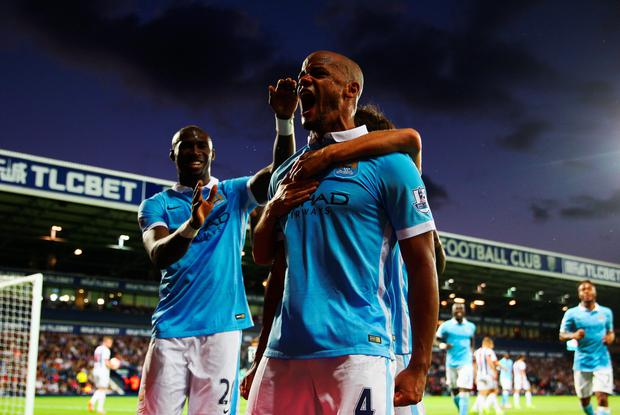 Vincent Kompany of Manchester City (4) celebrates as he scores their third goal during the Barclays Premier League match between West Bromwich Albion and Manchester City at The Hawthorns on August 10, 2015 in West Bromwich, England. (Photo by Michael Steele/Getty Images)