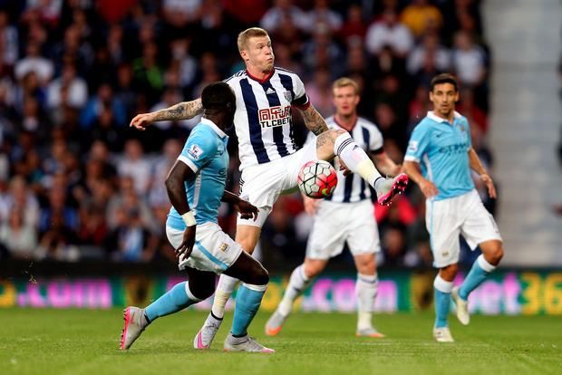 West Bromwich Albion's James McClean (right) and Manchester City's Bacary Sagna battle for the ball during the Barclays Premier League match at The Hawthorns, West Bromwich. Photo: David Davies/PA