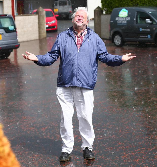 The Telegraph's Ivan Little caught in the rain at Newcastle