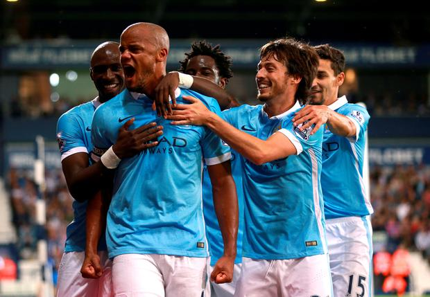 Manchester City's Vincent Kompany celebrates scoring his side's third goal