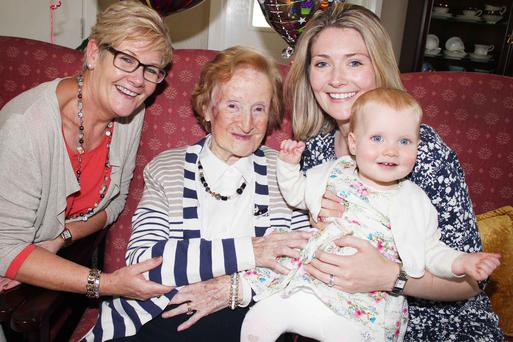 Belfast Telegraph reader Beattie Taylor who has just turned 100, with her daughter Pearl Stewart (left), granddaughter Emma Forrest and great-grandaughter Beth Forrest