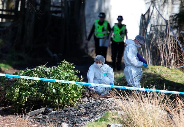 Police forensic investigators at High Craigton Farm on the north-western outskirts of Glasgow in April, where the body of missing student Karen Buckley was discovered. Andrew Milligan/PA Wire