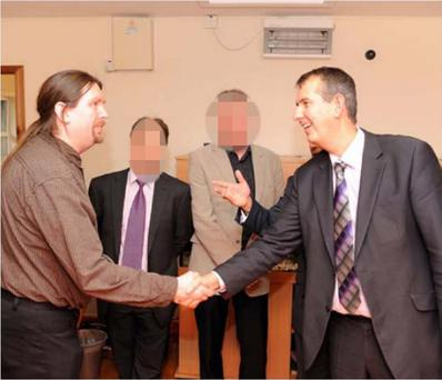 Darren Black (far left) meeting Edwin Poots at Glencarn House, Glengormley.