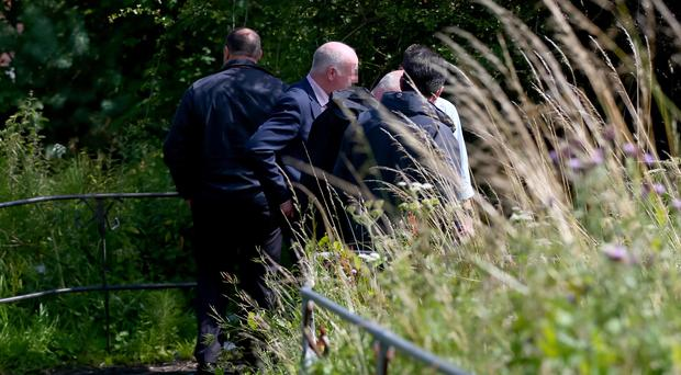 Police TSG officers drafted in from Co. Armagh accompanied by Murder Detectives searching forest land between the Foxes Glen area and Glenkeen for a cream bomber-style jacket Picture - Kevin Scott