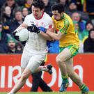 Turning point: Tyrone's Mattie Donnelly takes on Mark McHugh of Donegal in the Red Hands' 1-13 to 0-6 defeat in the Allianz League
