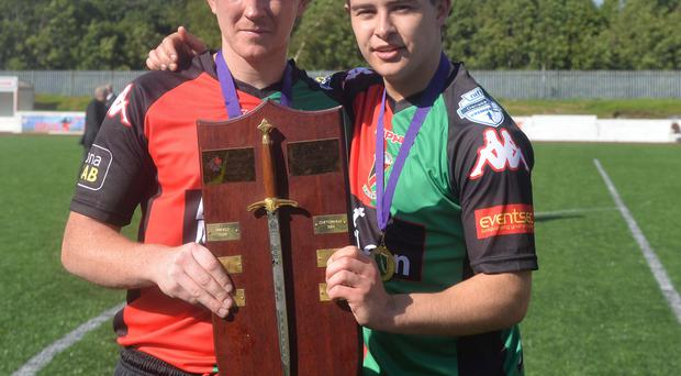Shield of dreams: Stephen McAlorum and Jordan Stewart pose with the Charity Shield after the latter's winner at Solitude