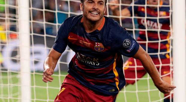 Match winner: Pedro wheels away after scoring for Barca