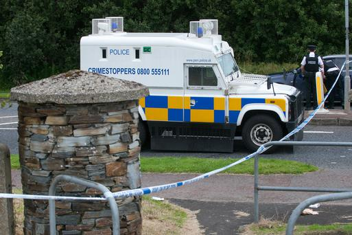 The security cordon on the Skeoge Road in Derry where a bin was destroyed
