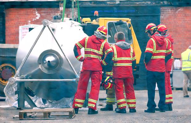 Police officers at the scene of the incident at the Hilden Brewery in Lisburn. Photo: Kevin Scott