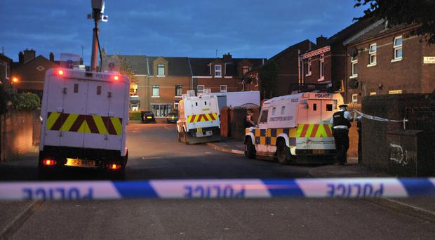Police at the scene where former IRA man Kevin McGuigan was shot dead in east Belfast