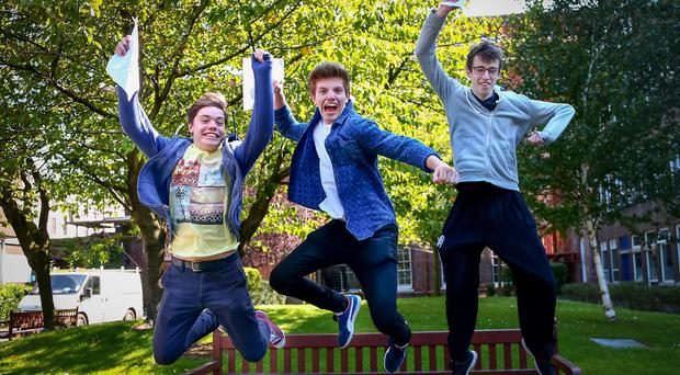 Belfast - Northern Ireland - Thursday 13th August 2015 - A Level Results Day Pictured is Daniel Murphy 3A* and 1 B , Jacob Davidson 1 A* 2A and 1 B and Chris Hogg 2A* 2A during A level results day at RBAI / Inst Picture - Kevin Scott / Belfast Telegraph