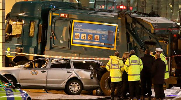 The scene in Glasgow's George Square after a bin lorry crashed in the city centre and killed six people