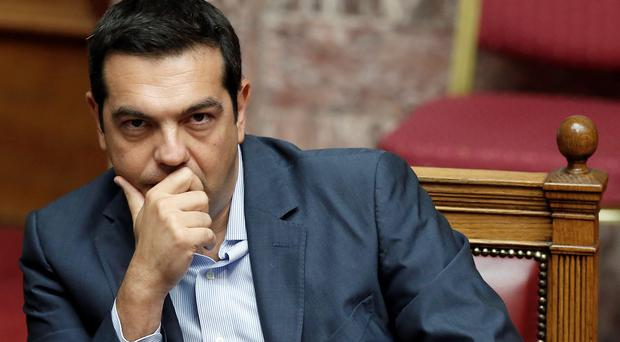 EU finance ministers have agreed on first £18.4 billion instalment of a vast new bailout package to help rebuild Greece's economy.. (AP Photo/Yannis Liakos)