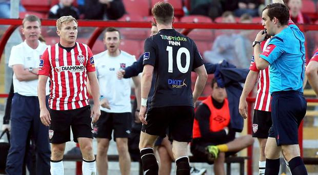 Red mist: Derry City's Conor McCormack is sent off by referee Robert Harvey at the Brandywell