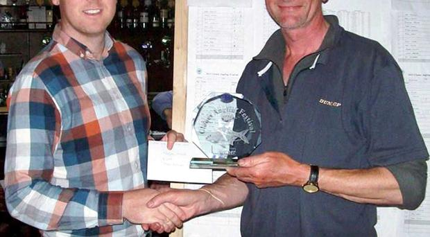 Prize guy: Tony Kersley receiving the Clones Coarse Fishing trophy from Patrick McCarville of Creighton Hotel, Clones