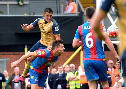 Arsenal's Alexis Sanchez heads the ball which is then turned in for an own goal by Crystal Palace's Damien Delaney (not pictured) during the Barclays Premier League match at Selhurst Park, London. Adam Davy/PA Wire.