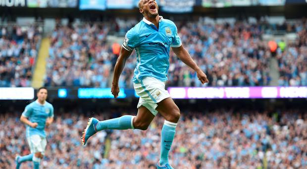 Manchester City's Vincent Kompany celebrates scoring his side's second goal of the game during the Barclays Premier League match at the Etihad Stadium, Manchester. Martin Rickett/PA Wire.