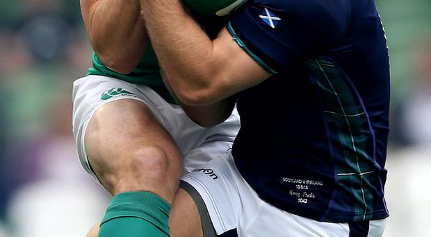 On the ball: Tommy Bowe wrestles with Greig Tonks of Scotland in the World Cup warm-up clash in Dublin