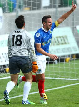 Back of net: Linfield skipper Andy Waterworth celebrates sealing his treble