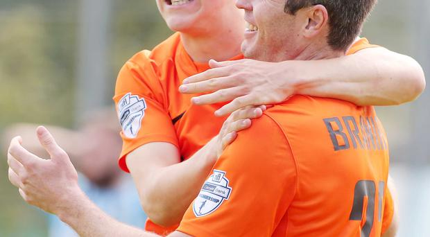 Damage done: Joel Cooper and Kevin Braniff celebrate
