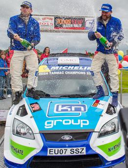 Lovely bubby: Ulster Rally champions Donagh Kelly and Kevin Flanagan celebrate their victory