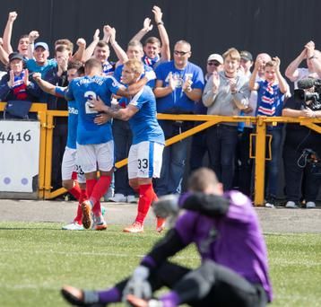Up and running: Rangers' James Tavernier (second left) opens the scoring