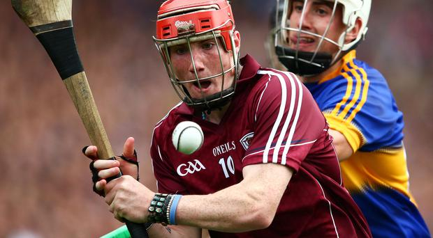 Closed down: Tipperary's Patrick Maher puts pressure on Conor Whelan of Galway INPHO