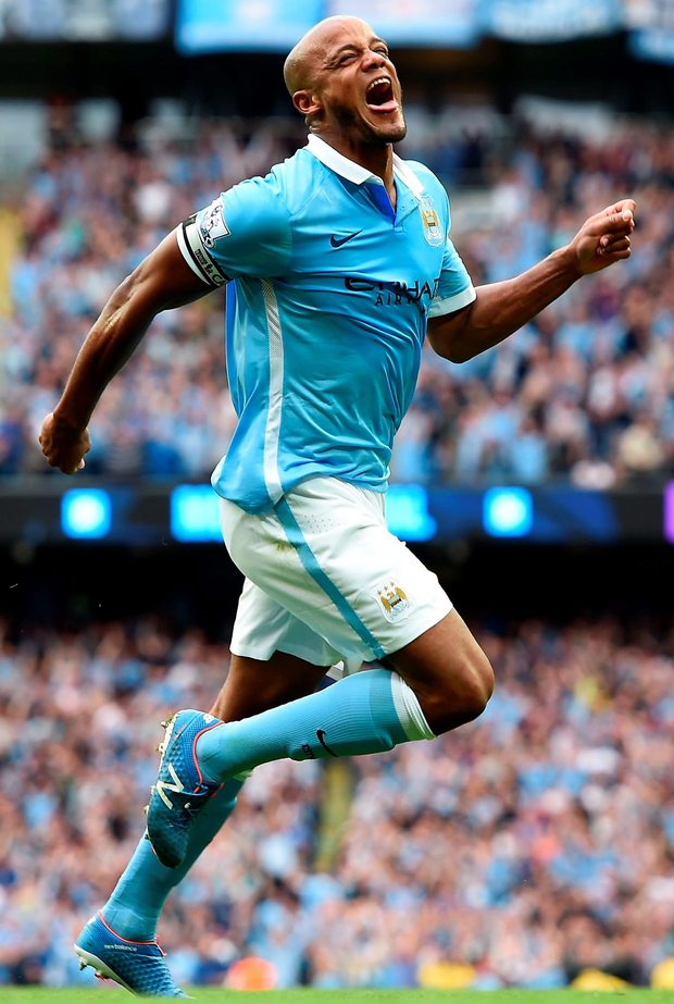 Manchester City's Vincent Kompany celebrates scoring his side's second goal of the game during the Barclays Premier League match at the Etihad Stadium, Manchester. PRESS ASSOCIATION Photo. Picture date: Sunday August 16, 2015. See PA story SOCCER Man City. Photo credit should read: Martin Rickett/PA Wire. EDITORIAL USE ONLY. No use with unauthorised audio, video, data, fixture lists, club/league logos or