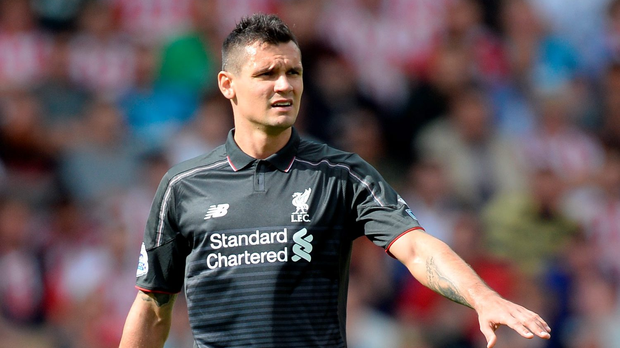 Liverpool manager Brendan Rodgers believes renewed confidence from Dejan Lovren will see the Croatian establish himself at the heart of defence this season. Pic Martin Rickett/PA Wire.