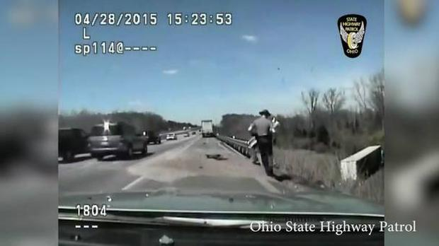 Don't you die on me: Eric Devers with the Ohio State Highway Patrol attended the crash scene
