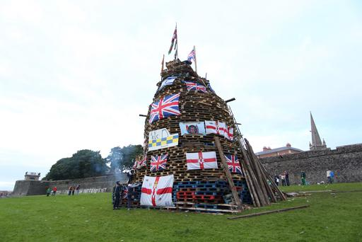 Flags and other symbols were placed on the bonfire. Pic Press Eye.