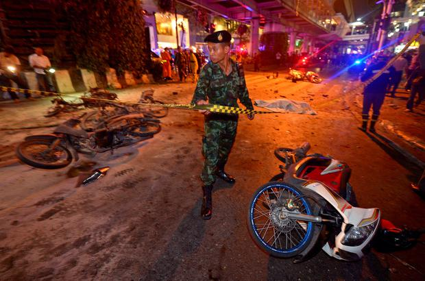 A Thai soldier ropes off the scene after a bomb exploded outside a religious shrine in central Bangkok late on August 17, 2015 killing at least 10 people and wounding scores more. AFP/Getty Images